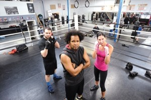 Staff photo/ IAN KELSO Virgil Barrow, trainer at the Kingsway Boxing Club, with boxers Shane Lewis-Stirling and Jane Watson who will take to the ring in the Fight to end Cancer benefitting Princess Margaret Hospital Foundation. March 29,2014.