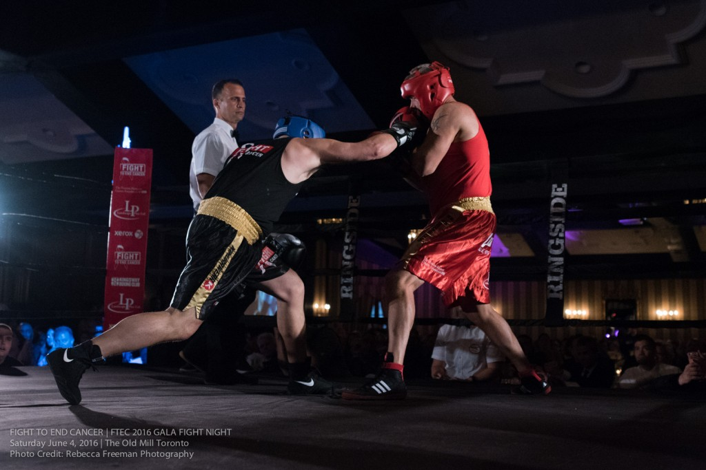 Main Event, Craig Lauzon lands a right-cross on his opponent Cory Raymond - all in the name of knocking out cancer! Photo Credit: Rebecca Freeman