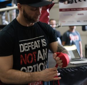 Jeff MacWilliams (FTEC2015 Fighter) wraps his hands in preparation for his training session Photo Credit: Rebecca Freeman
