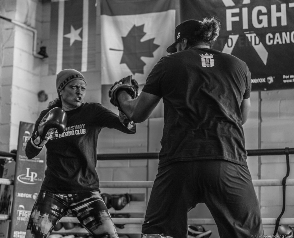 KBC Fight Team member, Shireen Fabing, puts in the work on the pads with her coach Virgil. Photo Credit: Jennifer Huggins