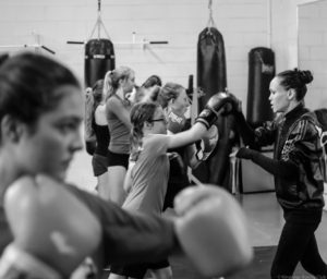 Jennifer Huggins leads the Girls Teens class at Kingsway Boxing, sharing her passion for the sport that changed her life. Photo Credit: Virgil Barrow