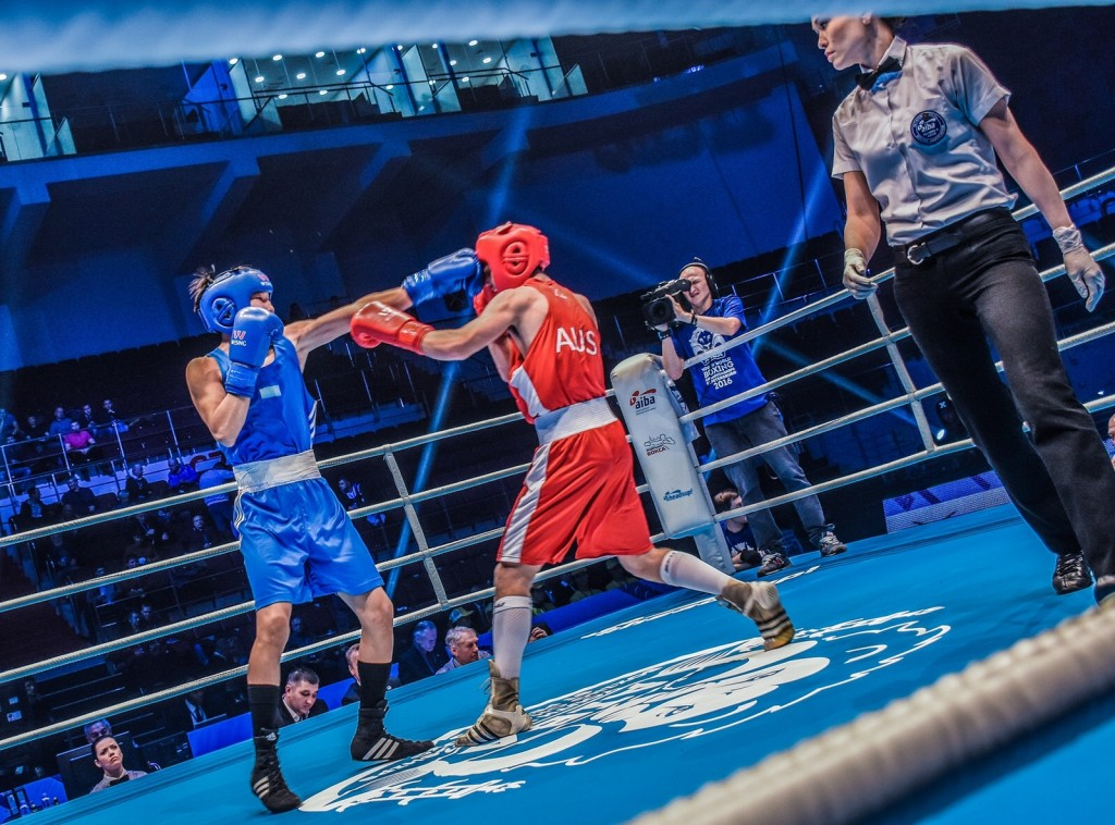 Jennifer Huggins referees a semifinal bout between Kazakhstan and Australia in the AIBA Men's Youth World Championships in St. Petersburg Russia. Photo Credit: AIBA International Boxing