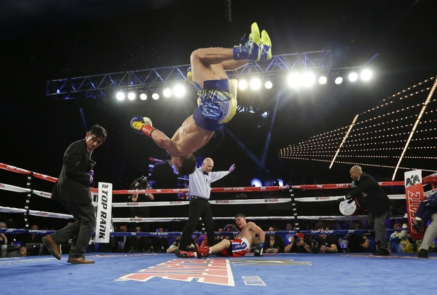 Photo From: Daily Mail UK | Vasyl Lomachenko, of Ukraine, does a backflip as he celebrates after knocking out Roman Martinez, of Puerto Rico, in the fifth round of a WBO junior lightweight title boxing match Saturday, June 11, 2016, in New York. Lomachenko stopped Martinez in the fifth round. (AP Photo/Frank Franklin II)