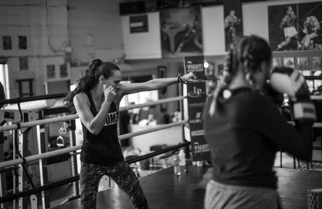 Photo Credit: Virgil Barrow Photography | Jennifer Huggins coaching at her gym Kingsway Boxing Club