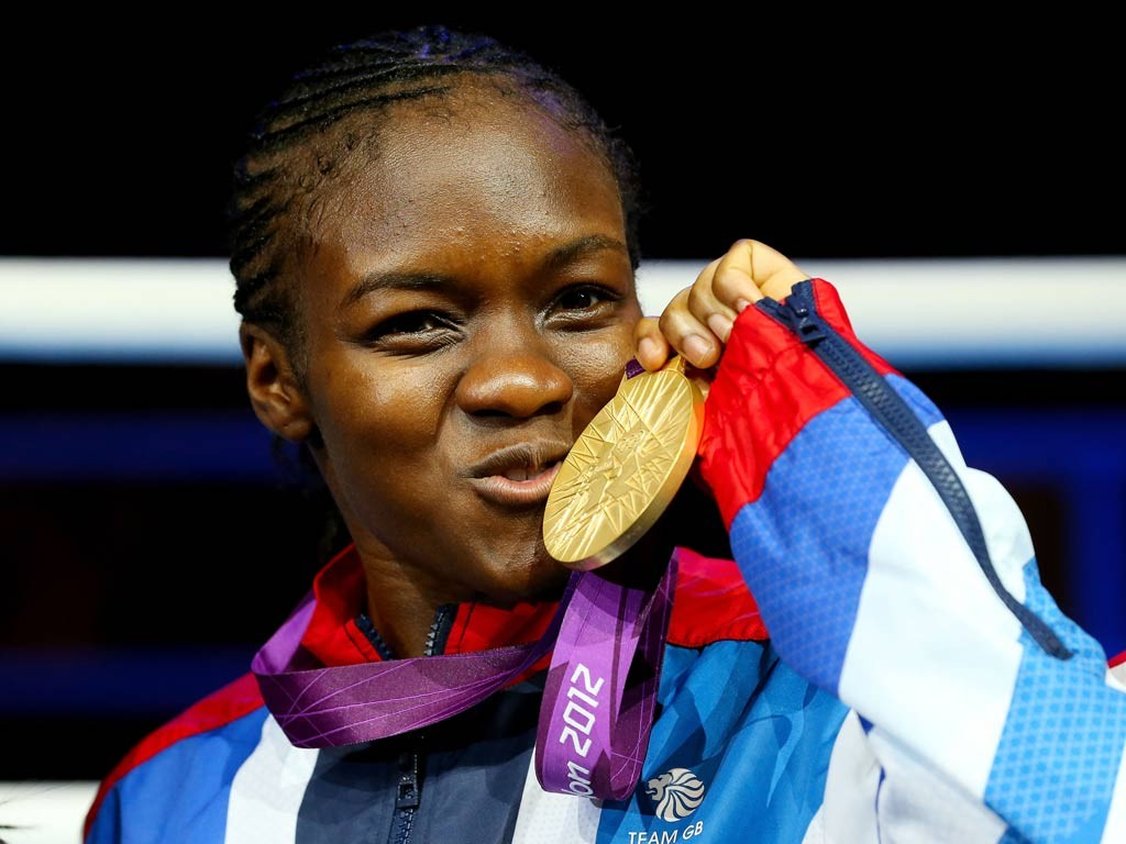 Nicola Adams took home gold in the 51kg at the 2012 London Olympics, where women debut in the sport with 3 Olympic weight classes. She went on to win her second consecutive gold medal for Britain at this past 2016 Olympics in Rio. Photo Curtesy Of: http://www.independent.co.uk/sport/olympics/comment/james-lawton-smiling-assassin-nicola-adams-bloodies-the-nose-of-every-one-of-the-boxing-sceptics-8027174.html