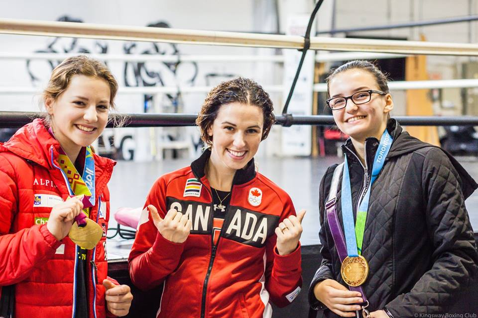 Photo By: Virgil Barrow | 2016 Olympian, Mandy Bujold, shares her medals from the 2015 PanAm Games with the Teen Girls of the 2016 Program at Kingsway Boxing Club.